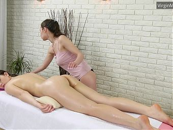 Adelyn Abbe enjoys being massaged by a girl
